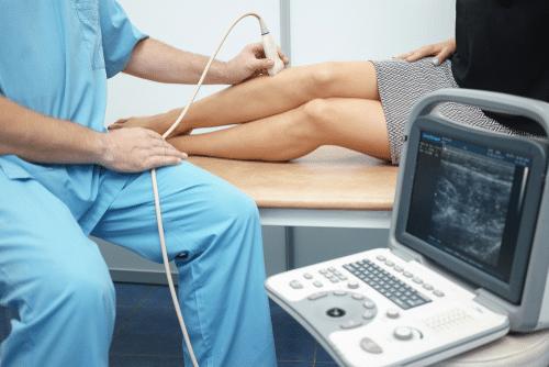 Patient receiving an arterial duplex scan on her legs